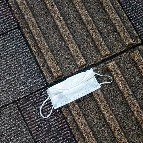 A medical mask on the ground